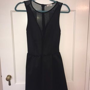 Black skater dress with sheer back and v neck